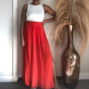 Tomato color pleated maxi skirt with slit